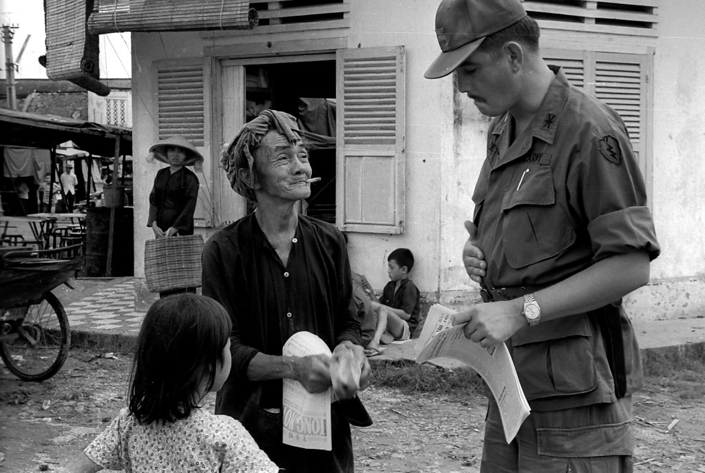 Soldier talking to civilian
